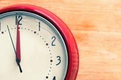Red alarm clock. On wood Stock Photos