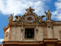 Clock on the top of Saint Peter's Basilica, Rome. St Peter's Basilica , Vatican Time Royalty Free Stock Image