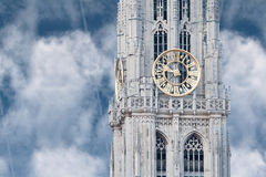 Clock tower. Gothic tower with golden clock shot against the blur sky royalty free stock photo