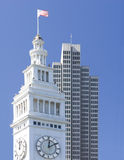 Clock Tower. An American flag flies from the Ferry Building in San Francisco Royalty Free Stock Photos