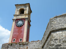 Clock Tower. Historical red clock tower on the island of Corfu, Greece Stock Photo