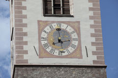 Clock tower. Detail of a clock tower painted and brass clock Royalty Free Stock Image