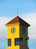 Clock Tower. A yellow Clock tower just after 6 o'clock Royalty Free Stock Photos