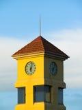 Clock Tower. A yellow Clock tower just after 6 o'clock royalty free stock photos