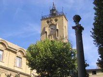 Clock tower, Aix-en-Provence, France. Stone clock tower, with ornamental wrought iron work on top, Aix-en-Provence, France Royalty Free Stock Images