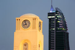 Clock Tower and Bahrain Financial Harbour. Clock Tower near Lulu Centre, Manama, Bahrain Royalty Free Stock Photography