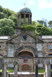 Clock tower in Bantry Gardens West Cork Ireland. With trees in the background royalty free stock images