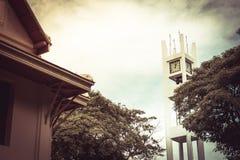 Clock tower and big tree on blue sky at bangkok thailand vintage Stock Image
