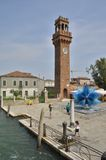 Clock tower and a blue murano glass sculpture Royalty Free Stock Image