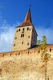 Clock tower and brick wall of ancient citadel. Of aiud in transylvania land of romania Royalty Free Stock Image