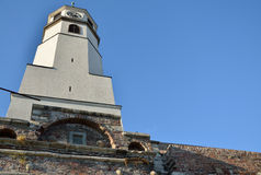 Clock tower on brick walls with blue sky. In background (Kalemegdan Fortress, Belgrade Royalty Free Stock Image