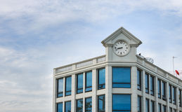Clock tower. On building with blue sky background Stock Images