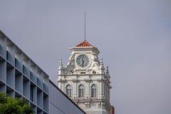 Clock tower of building near Plaza San Martin at Rivadavia and Rosario de Santa Fe street corner - Cordoba, Argentina royalty free stock images