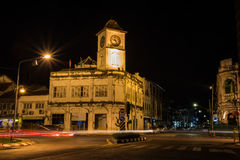 Clock tower building at Old Phuket town. Old clock tower building at Old Phuket town classic and romantic place this is the landmark of phuket town , Thailand Stock Photos