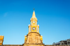 Clock Tower of Cartagena. The yellow clock tower marking the entrance to the old town of Cartagena, Colombia Royalty Free Stock Photography