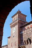 Clock tower of castello estense from arch Royalty Free Stock Images