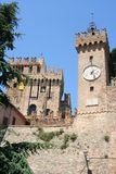 Clock tower of a Castle in Marche, italy Stock Photography