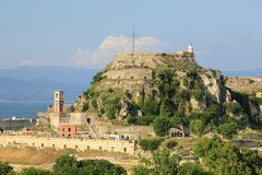 The Clock Tower and Castle Near The Land Peak with the Lighthouse of the Old Fortress of Corfu, Kerkyra, Corfu Island, Greece, Eur royalty free stock photos
