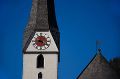 Clock tower on a church with blue sky Stock Photo