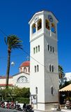 Clock tower and church, Elounda. Royalty Free Stock Images