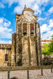 Clock tower of church Our Lady Populace in Caldas da Rainha ,Portugal. Clock tower of church Our Lady Populace in Caldas da Rainha city in Portugal royalty free stock images