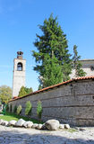 Clock Tower and Church Wall in Bansko. Clock tower and the wall of St. Trinity church in the center of Bansko. Bansko is a town in southwestern Bulgaria, located Royalty Free Stock Image