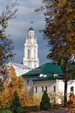Clock tower on City Hall in Vitebsk. Clock tower on the Building of municipality and the downtown buildings in the early fall Stock Photos