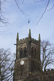 Clock tower. Close up of a typical English church clock tower Stock Photography