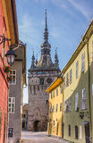 Clock tower and colorful houses of the citadel in Sighisoara Royalty Free Stock Image