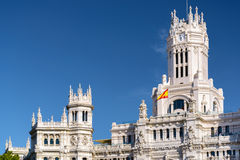 Clock tower of the Cybele Palace (Palacio de Cibeles) in Madrid Royalty Free Stock Photo