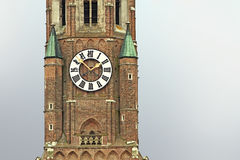 Clock tower detail of medieval St. Martin church in Landshut Royalty Free Stock Images