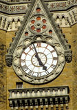 Clock tower detail  in Mumbai India. Clock tower in Mumbai, India, under blue sky Stock Photography
