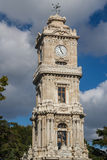 Clock tower of Dolmabahce palace in Istanbul Stock Images
