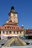 Clock Tower in downtown. Churches, gates, towers, walls, buildings and ancient streets in downtown Brasov. Old windows, plaster slab, archways, green tourists stock photography