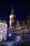Clock tower in Dresden at night. Clock tower in Dresden on Theaterplatz square at night with street lights illumination, Germany, Europe royalty free stock image
