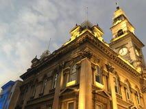 Clock tower, Dunedin, New Zealand. Outside of clock tower in Dunedin, New Zealand on sunny day Stock Image