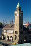 Clock Tower of the famous Landungsbruecken in Hamburg. HAMBURG, GERMANY - OCTOBER 11, 2015: Famous Hamburger Landungsbruecken with commercial harbor and Elbe royalty free stock images