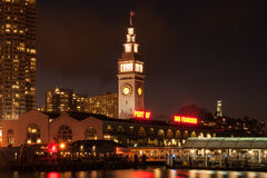 Clock tower of Ferry Building. Lit up at night, The Embarcadero, San Francisco, California, USA royalty free stock photo