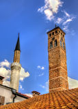 Clock tower and Gazi Husrev-beg Mosque Royalty Free Stock Photography