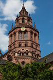Clock Tower on German Church. A portion of a building in Germany that shows architecture of the period. The photo contains a blue sky background with white Royalty Free Stock Photography