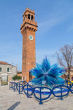 Clock Tower and Glass Sculture in Campo Santo Stefano in Murano Stock Image
