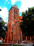 Clock tower at gothic church at Wismar, Germany stock image