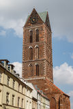Clock tower of the gothic church in Wismar old town. Germany Royalty Free Stock Photo