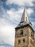 Clock tower of the Grote Kerk, Enschede, Netherlands. Low angle view looking up at the clock tower of the Grote Kerk Great Church in the Oude Markt Old Market of Royalty Free Stock Images