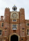 Hampton court palace, Richmond, UK. Clock tower of Hampton court palace with blue sky, Richmond, United Kingdom Royalty Free Stock Photo