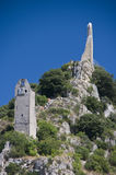 Clock tower on a hill. An old clock tower standing on a hill under clear blue skies Stock Images
