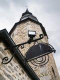 Clock Tower in historic center of Dinan town. Travel to France - Clock Tower in historic center of Dinan town in rain Royalty Free Stock Photos