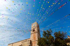 Clock tower, and holiday flags in a small town Stock Images