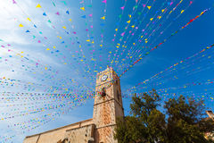 Clock tower, and holiday flags in a small town Royalty Free Stock Photography