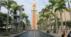 Clock Tower Hong Kong. Hong Kong, China - December 5, 2016: landmarks in Tsim Sha Tsui in Victoria Harbour waterfront, ancient Clock Tower with its palms and stock video footage